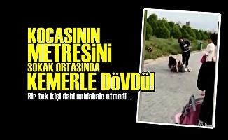 KOCASININ METRESİNİ KEMERLE DÖVDÜ!